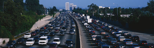 Rush hour traffic. This is rush hour traffic on the 405 Freeway at sunset. There are 10 lanes of traffic total showing both sides of the freeway. There are cars Stock Images