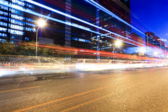 Rush hour traffic in beijing at night. The light trails on the modern building background in rush hour traffic at night Stock Photography