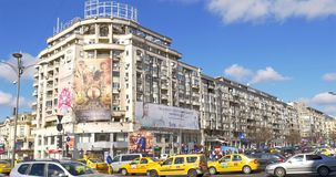 Rush Hour Traffic And Busy People In Union Square (Piata Unirii) Downtown Of Bucharest City. BUCHAREST, ROMANIA - MARCH 08, 2016: Rush Hour Traffic And Busy stock video footage
