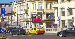 Rush Hour Traffic And Busy People In Union Square (Piata Unirii) Downtown Of Bucharest City. BUCHAREST, ROMANIA - MARCH 08, 2016: Rush Hour Traffic And Busy stock footage