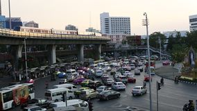 Rush hour of traffic circle near the Victory Monument BTS Station. stock video footage