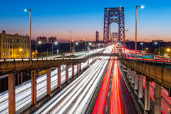 Rush hour traffic on George Washington Bridge. Rush hour traffic with light trails on George Washington Bridge, in New York City Stock Photos