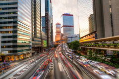 Rush Hour Traffic in Hong Kong. Urban rush hour traffic in Hong Kong`s downtown Connaught Road Central business hub during sunset hours Stock Images