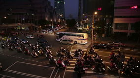 Rush hour traffic at intersection in Xinyi Financial district in Taipei. TAIPEI, TAIWAN - MARCH 19, 2015: Rush hour traffic at intersection in Xinyi Financial stock video footage