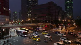 Rush hour traffic at intersection in Xinyi Financial district in Taipei. stock video