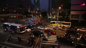 Rush hour traffic at intersection in Xinyi Financial district in Taipei. TAIPEI, TAIWAN - MARCH 19, 2015: Rush hour traffic at intersection in Xinyi Financial stock video