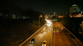 Rush Hour Traffic on Interstate 84 Banfield Freeway with Portland Downtown City Skyline at Night 1080p stock footage