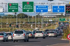 Rush hour traffic jam on Auckland motorway. With cars waiting in long queue royalty free stock image