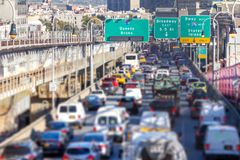 Rush hour traffic jam in New York City. Rush hour traffic jam with cars, trucks, buses, and taxis on the Williamsburg Bridge in Brooklyn New York City NYC Stock Images