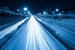 Rush hour traffic at night. Light trails on the fast lane Stock Images