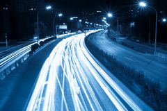 Rush hour traffic at night. Light trails on the modern city Stock Image