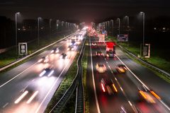 Busy highway traffic with light trails royalty free stock images