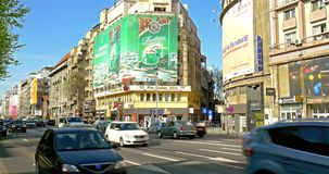 Rush Hour Traffic In University Square Downtown Of Bucharest City. BUCHAREST, ROMANIA - APRIL 05, 2015: Rush Hour Traffic In University Square Downtown Of stock footage