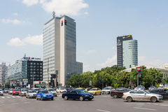 Rush Hour Traffic On Victory Square. BUCHAREST, ROMANIA - JUNE 09, 2014: Rush Hour Traffic On Victory Square. Is a major intersection in central Bucharest of Royalty Free Stock Images