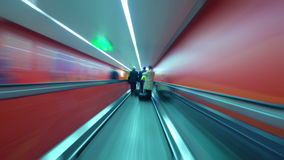 Rush hour underground tunnel. People walking through red tunnel stock video