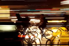 Rushhour with cyclists at night stock photography
