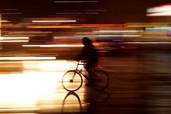 Rushhour with cyclists at night stock images