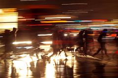 Rushhour with cyclists at night stock photo