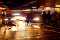 Rushhour with cyclists and pedestrians at night stock photo