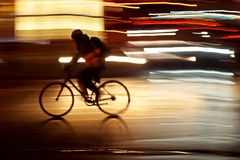 Rushhour with cyclists and pedestrians at night stock photography