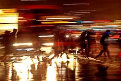 Rushhour with cyclists and pedestrians at night stock images
