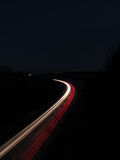 Rushhour trails. Light trails of rushhour traffic in the dark Stock Photos