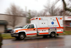 Rushing Ambulance for emergency. A moving ambulance on it''s way to a crash site royalty free stock photo