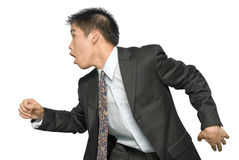 Rushing Asian young businessman Royalty Free Stock Photos