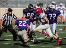 Rushing Attack. All star football action at the NORCAL Lions Club Game  in Oroville, California Stock Image