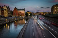 Rushing cars on Centralbron bridge, Gamla Stan, Stockholm, Swede stock photography