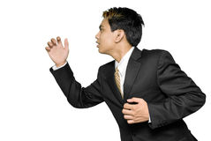Rushing Indian young businessman Stock Image