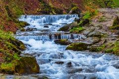 Rushing mountain river Stock Photos