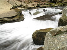 Rushing river. Blurred rushing river with long exposure. Tennessee river and rocks stock photo