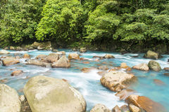 Rushing River. A blue river flows Stock Photos
