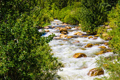 Rushing Stream Over Rocks From Snow Melting stock images