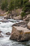 Rushing stream river water through Eleven Mile Canyon Colorado Stock Photo
