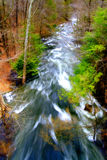 Rushing stream in springtime. Overhead view of a rushing brook in a forest setting with springtime foliage on the trees...taken in Putnam County, New York, USA Stock Photo
