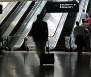 Rushing to the gate. Business traveler gets a workout dashing to the gate Stock Images