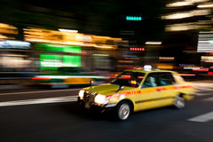 Rushing through Tokyo by night royalty free stock photography