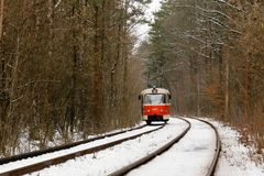 Rushing tram through the winter forest Royalty Free Stock Photo