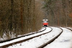 Rushing tram through the winter forest Stock Images