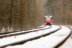 Rushing tram through the winter forest Stock Photography