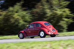 Rushing Volkswagen Beetle Stock Images