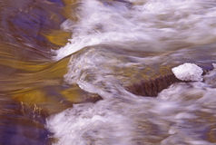 Rushing water. Over rocks and ice Royalty Free Stock Images