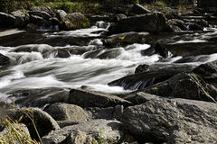 Rushing water over rocks Royalty Free Stock Photos