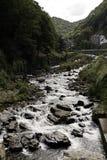 Rushing water over rocks Stock Photo