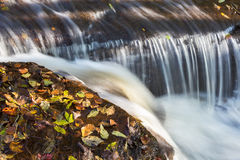 Rushing water over rocks Royalty Free Stock Photo