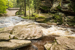 Rushing water over rocks Stock Photography