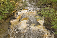 Rushing Water over Unusual Rocks Stock Photography