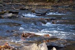 Rushing water on the river Stock Photo